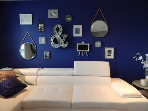 White sofa with blue wall